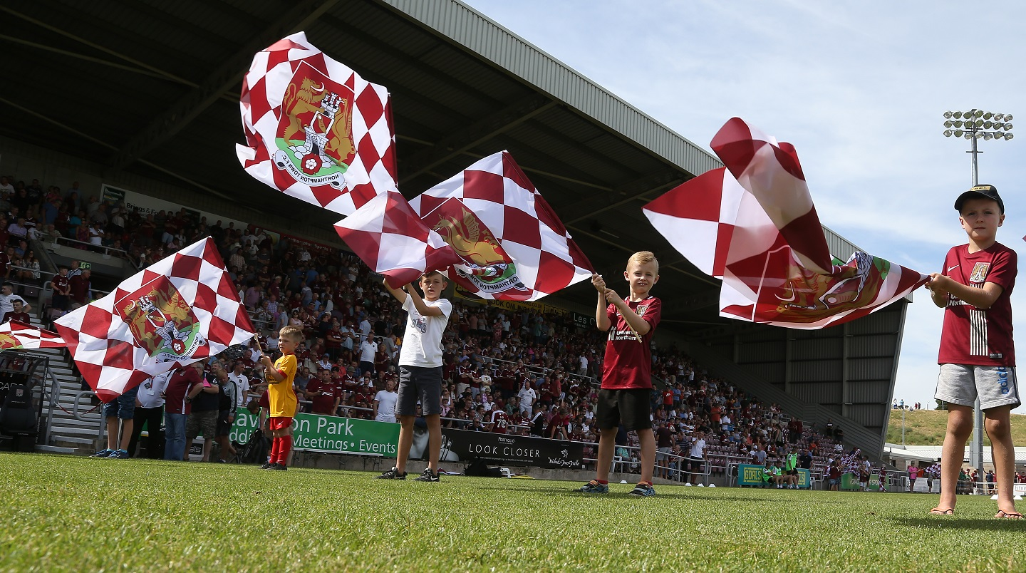 Flag waving at the PTS Academy Stadium